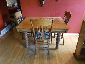 Early 1900's solid oak dining room table with 4 chairs