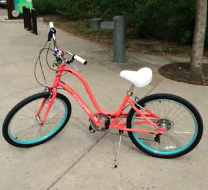 STOLEN: Coral pink Townie Electra bike