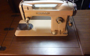Sewing machine with intergrated desk