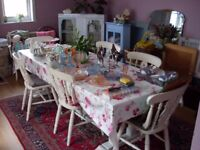 Long slatted wood table and 6 farmhouse chairs for sale