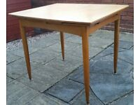 extendable wooden dining table. Used condition with some cosmetic wear and tear.