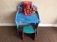 Unisex child's desk and chair with Winnie The Pooh soft toys.