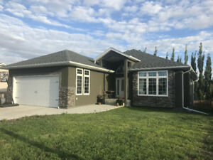 Custom built bungalow in desirable Highland! Location! Location!