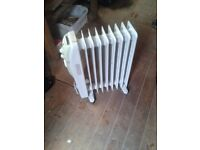 Oil filled heater with built in timer