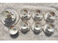 Floral design and gold rim and handle 21 pieces set