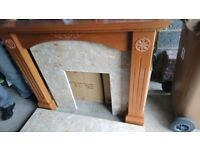 Wooden fire place with marble surround