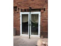 French doors, double glazed, chrome handles, white uPVC. W 180cm x H 214cm