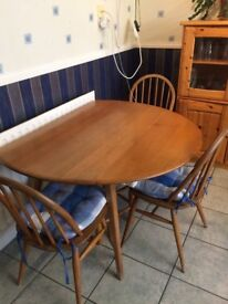 Ercol circular drop leaf table and 4 chairs