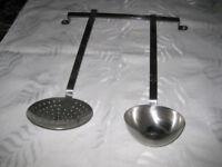 rack with kitchen utensils