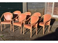 Chairs for sale - 7 wooden with orange seats and 2 with purple seats . Good quality - £5.00 each