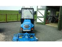 Compact tractor with grass cutting implements