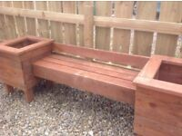 New garden bench with wnd planters