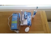 Braun Oral B electric toothbrush complete with charger and instructions
