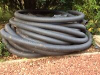 Field drain 100mm perforated plastic pipe, approximately 50 to 60 metres coil