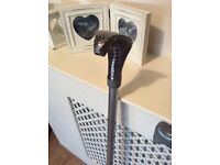 2 adjustable walking sticks snakes head on one