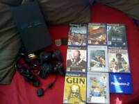 PlayStation 2 bundle. 8 games, 2 controllers, 2 memory cards.
