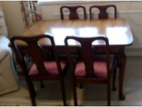Strongbow walnut dining table, with six chairs and matching sideboard.