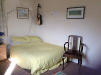 Spacious and bright room in house in Cramond with garden and free parking.