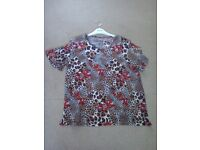 Leopard print top size 20/22 round neck and short sleeve