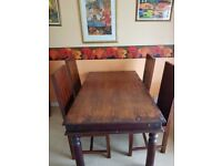 dining table and 4 hardwood chairs