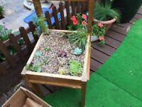 2 wooden upcycled chair planters