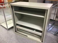 grey metal cabinet, 2 adjustable shelves, 1 hanging file rail, no doors