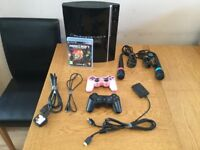 PS3 80gig with MineCraft game and 2 controls + 2 microphones