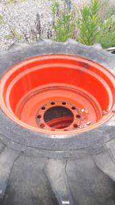 Tractor tires full set and a spare hold air