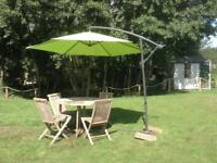 Teak Garden Table with four chairs and Cantilever Umbrella