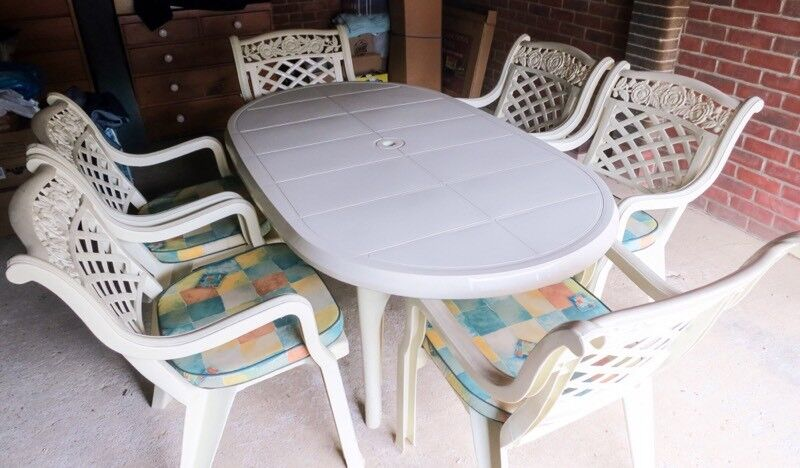 """Garden Tablein Ely, CambridgeshireGumtree - The Cambridge Set in Cream This isnt your cheap plastic table and chairs Large oval table size is 39"""" X 67""""6 stacking Carver armchairs6 pad cushionsA parasol and a matching base (15 items)The base can be filled with either sand or water Parasol..."""