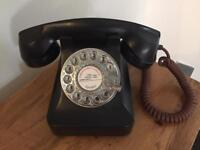 Old fashioned style working black telephone