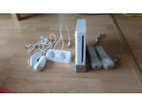 Nintendo Wii (Includes 2 x Remotes, 2 x Nun-Chucks, Charging Station + 2 x Rechargeable batteries)