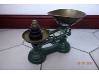 Cast Iron Kitchen Scales. Green/Gold. Complete with weights from 1/4oz - 1 lb. Good condition.