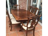 American walnut dining table and chairs