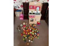 Wooden kitchen with playfood pans cutlery kettle