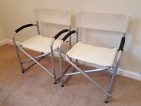 Pair of chairs for garden and patio. Director style. As-new condition. Compact when folded.