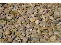Decorative pebbles approximately 50 - 100 mm in size, smooth texture.