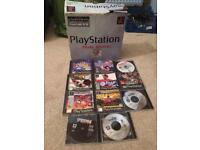 Boxed Sony ps1 console and games
