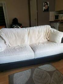 Leather 2 seater sofa and matching reclining chair
