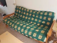 Solid wooden 3 seater futon sofa bed.