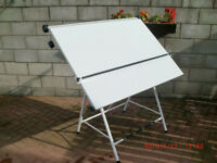 This A1 drawing board is white on a white stand would suit a graphics person angle change