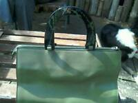 Green Handbag synthetic material.
