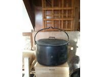 Black cast iron cauldron cooking pot