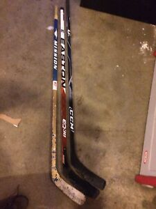 Left handed composite one piece hockey sticks