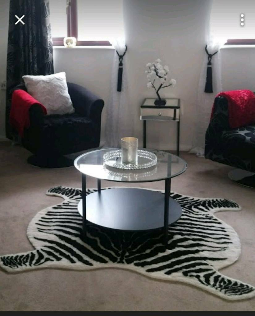 Ikea Circular Glass And Black Frame Coffee Table Zebra Rug