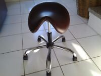2 Saddle seat stools. Can change height. Wheels