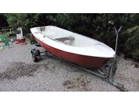 Sailing/rowing/motor boat . Safe unsinkable 12 foot dinghy with combi trailer and outboard.