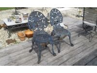 PAIR OF MATCHING CAST IRON (NOT ALLOY) HEAVY GARDEN PATIO CHAIRS VERY PRETTY AND SOUND CONDITION.