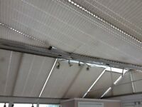 Sun reflecting pleated conservatory roof blinds.