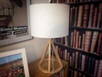 Tripod table lamp natural wood. Offers welcome